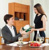 Girl giving gift during dinner — Foto de Stock