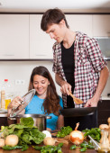Man and woman cooking together — Stock Photo