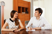 Girl answer questions at office — Stock Photo