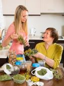 Mother and daughter with herbal tea — Stock Photo