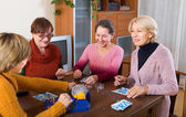 Female friends sitting with lotto — Stock Photo