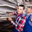 Workers at window production warehouse — Stock Photo #69432383