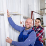 Workmen choosing PVC window profile — Stock Photo #69432555