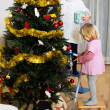 Girls decorating christmas tree — Stock Photo #69436191