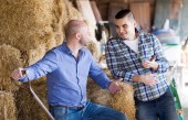Two farm workers in hayloft — Stock Photo