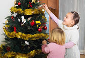 Children decorating christmas tree — Stock Photo