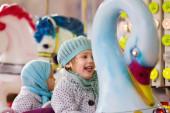 Girls ride on the merry-go-round — Foto de Stock