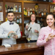 Girl flirting with barman at counter — Stock Photo #69441391