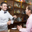 Girl flirting with barman at counter — Stock Photo #69442645