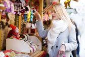 Girl shopping at Christmas market — Stock Photo