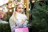 Blond woman at holiday fair — Stock Photo