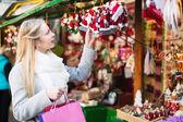 Female shopping at festive fair — Stock Photo