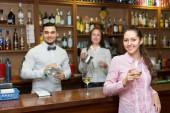 Girl flirting with barman at counter — Стоковое фото