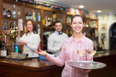 Nippy with beverages and bar crew — Stock Photo
