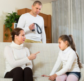 Parents scolding daughter at home — Stock Photo