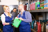 Mechanics choosing antifreeze liquid — Stock Photo