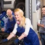 Female mechanic fixing car — Stock Photo #69580045