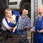 Beautiful female mechanic fixing car — Stock Photo #69580071