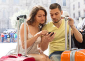 Travellers using mobile navigating system — Stock Photo