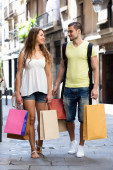 Young tourists in shopping tour — Stock Photo