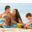 Family resting at beach — Stock Photo #69599283
