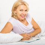 mature woman  writing in diary  — Stock Photo #72147449