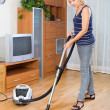 Woman cleaning with vacuum cleaner — Stock Photo #72148423