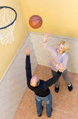 Elderly people playing with ball — Stock Photo
