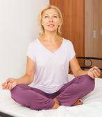 Mature woman practicing yoga  — Stock Photo