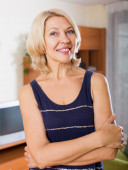 Smiling mature woman  in home or office — Stock Photo