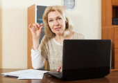 Serious mature woman with documents — Stock Photo