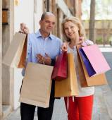 Family with bags after shopping — Stock Photo