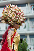 person in plumage at Gay pride parade in Sitges — Stock Photo