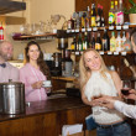 Couple drinking wine at bar — Stock Photo #72164975