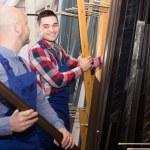 Two workers choosing PVC window profile — Stock Photo #72166299