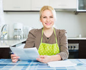 Woman with documents at kitchen — Stock Photo