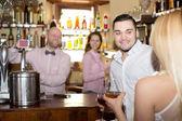 Restaurant visitors drinking wine — Stock Photo