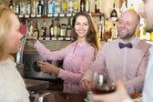 Couple drinking wine at bar — Stock Photo