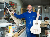 Guitar-maker at workshop — Stock Photo