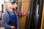 Workmen inspecting window frames — Zdjęcie stockowe