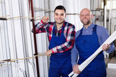 Workers posing in PVC shop — Stock Photo