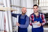Two smiling workmen at factory — Stock Photo