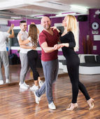 Couples enjoying of partner dance — Stock Photo