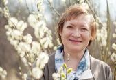 Smiling senior woman  in spring — Stock Photo