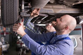Two specialist fixing car — Stock Photo