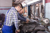 Mechanics working at workshop — Stock Photo