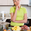 Confused housewife at kitchen — Stock Photo #72170693