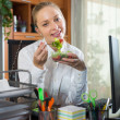 Businesswoman having lunch in office — Stock Photo #72172047