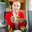 Businesswoman having lunch in office — Stock Photo #72172057