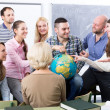 Teacher and happy adult students — Stock Photo #72174859